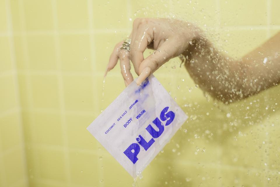 Plus body wash sachet in shower