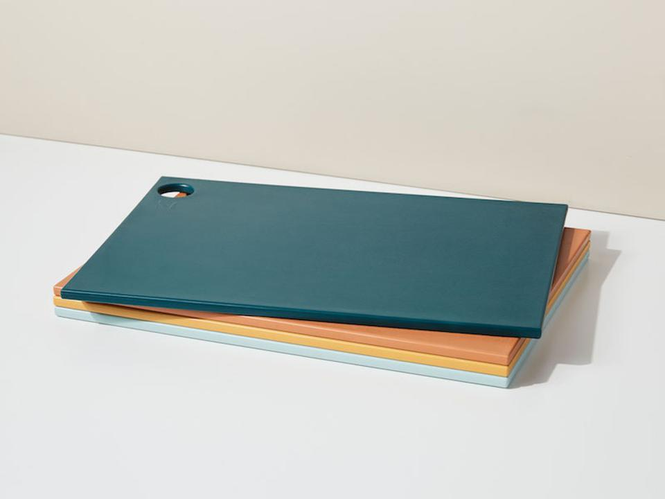 Stack of colorful cutting boards