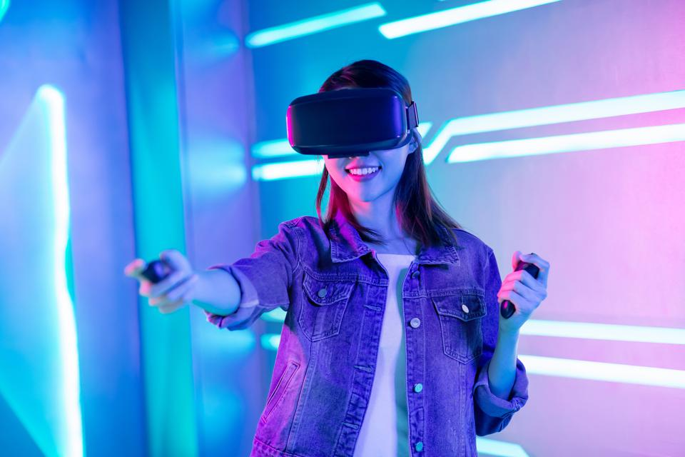 Asian woman wearing vr glasses