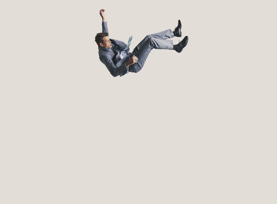 Businessman in big space, falling down