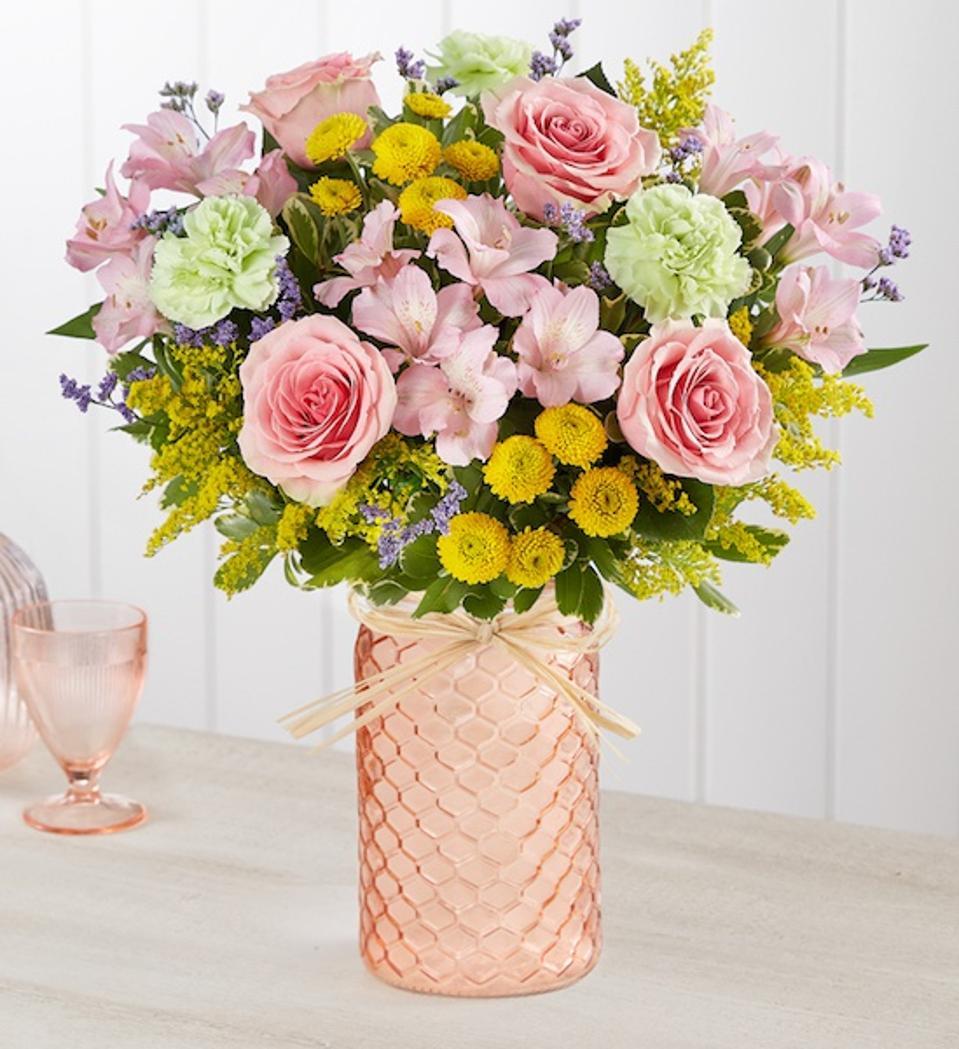1800 Flowers Pastel Posy Bouquet in an orange clear vase