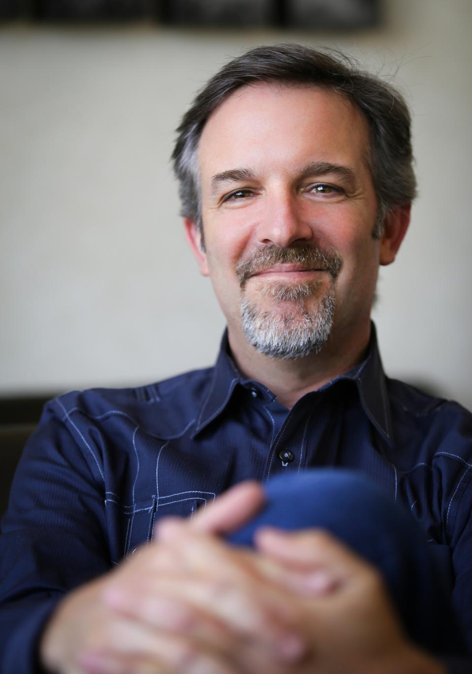 A headshot of a man in a blue shirt, Dr. Dan Peters.