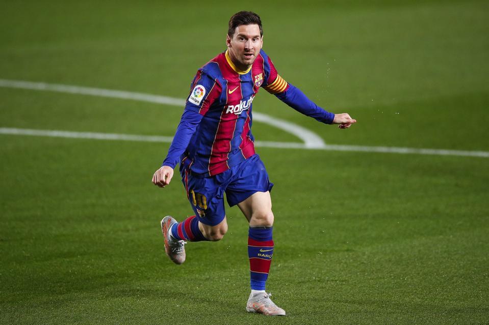 Lionel Messi celebrates scoring a soccer goal