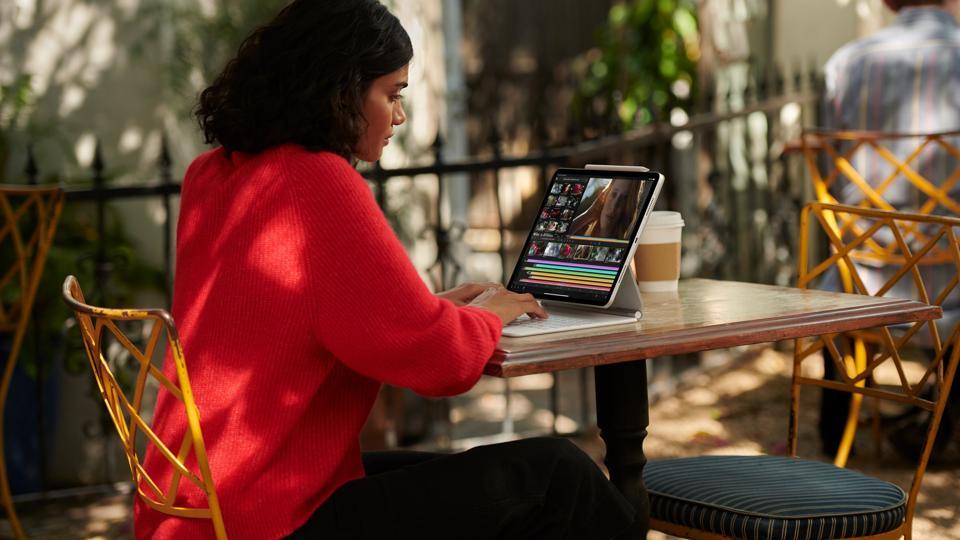 Woman typing on iPad Pro keyboard