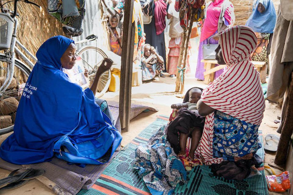 Volunteers like Jummai, left, have played a critical role in reaching otherwise hard-to-reach kids with polio vaccinations and other services.