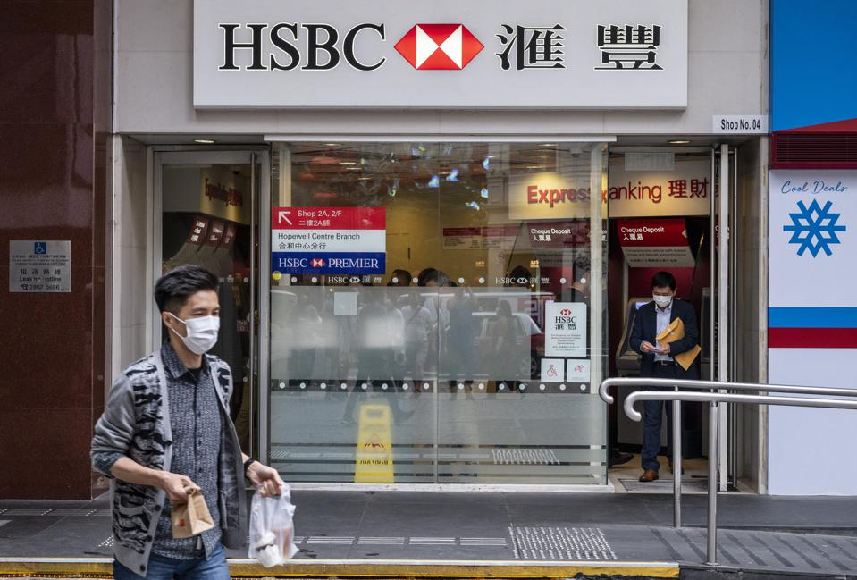A customer exits the British multinational banking and...
