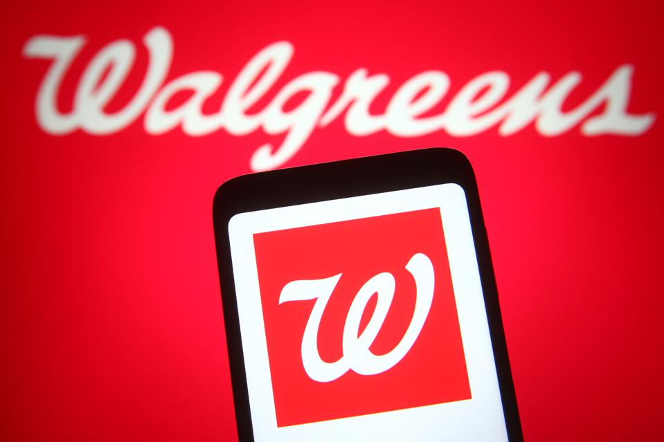 In this photo illustration the Walgreens logo is seen on a...