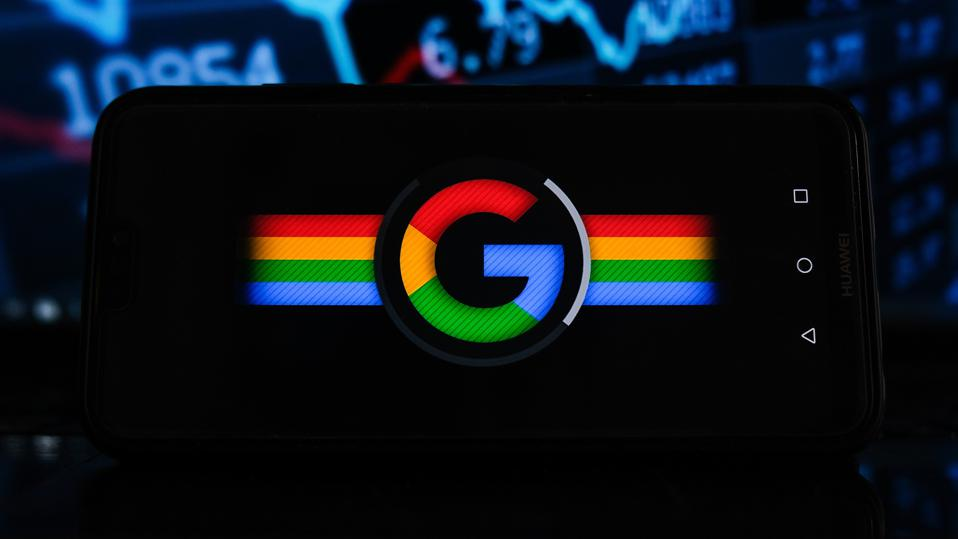 In this photo illustration a Google logo seen displayed on a...