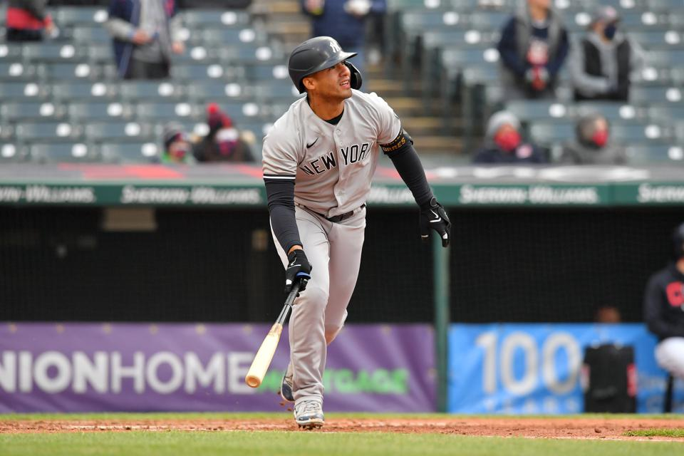 Gleyber Torres hits a single for the Yankees at Progressive Field.