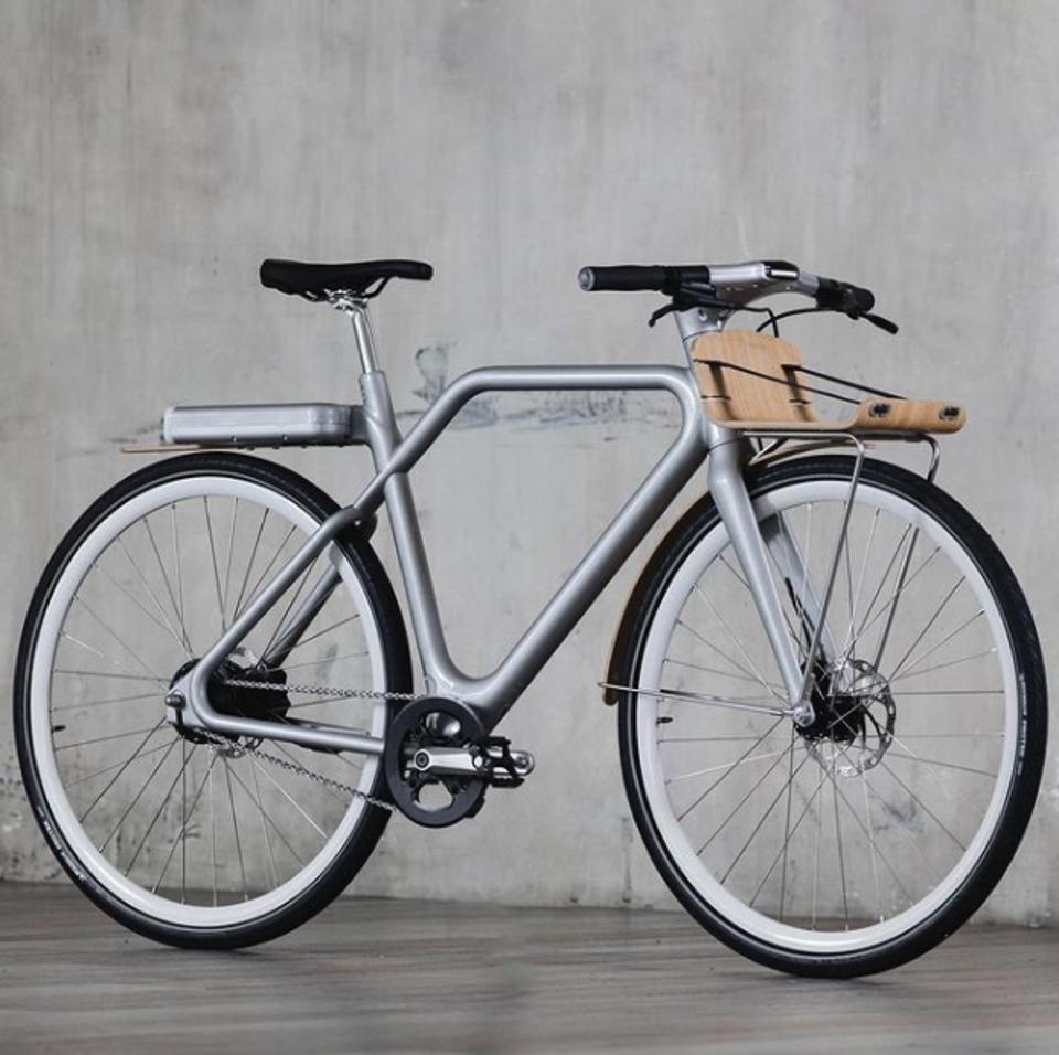 a stylish and futuristic designed lightweight bike in silver