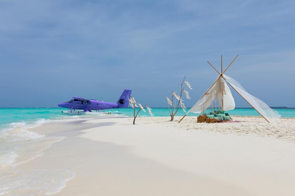 A seaplane on the shores of The Nautilus Maldives.