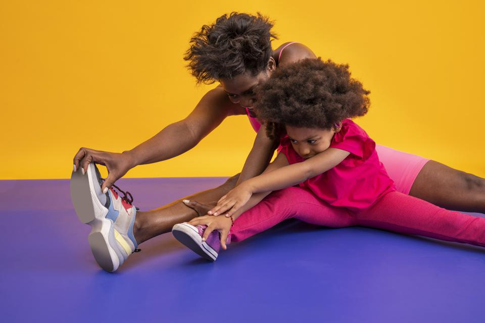 Mother and daughter african american fitness