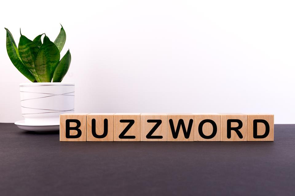 The word ″BUZZWORD″ made with building blocks on a light background