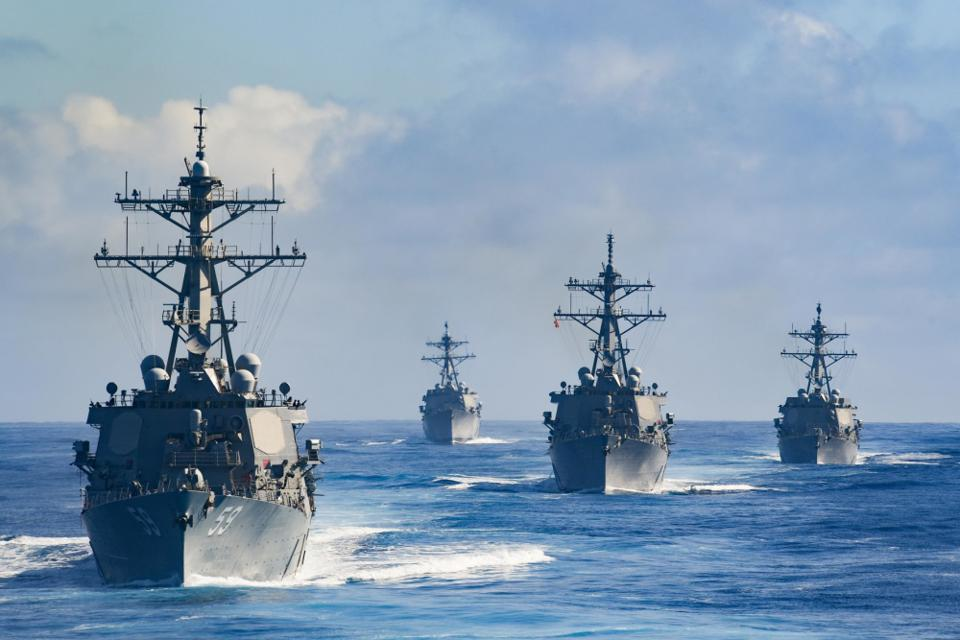 Four warships at sea in the Pacific.