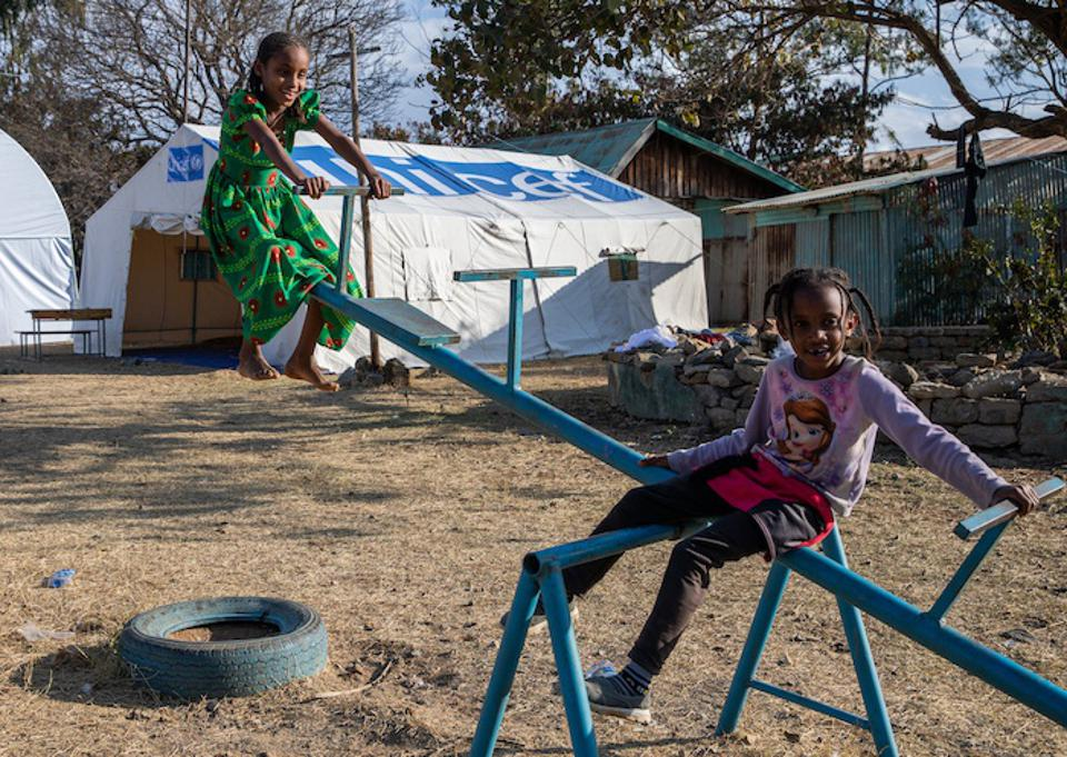 Two girls play in a Child-Friendly Space set up by UNICEF at the Meseret Primary School in Mekelle Town, one of two dozen schools in Tigray now serving as temporary shelters for those displaced by ongoing conflict in the region.