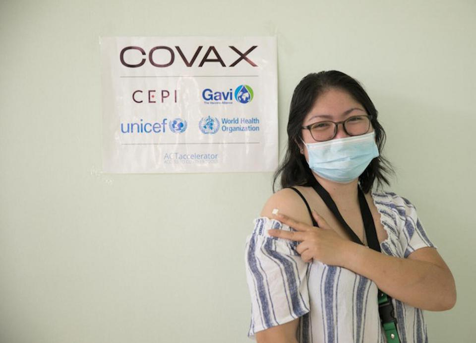 On March 10, 2021, Dr. Paula Syrah Esguerra, 37, fellow-in-training for maternal-fetal medicine at Dr. Jose Fabella Memorial Hospital in Manila, gets her first dose of the COVID-19 vaccine provided by the COVAX Facility.