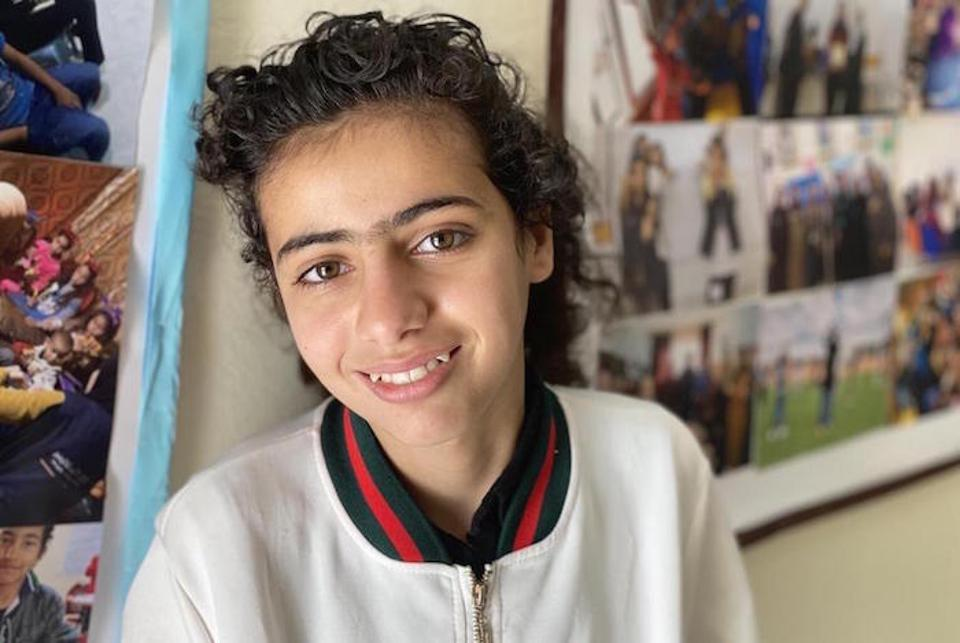 In Mafraq, Jordan Rimas, 10, attends a UNICEF-supported Makani Center, where the walls are decorated with photographs and children's artwork.
