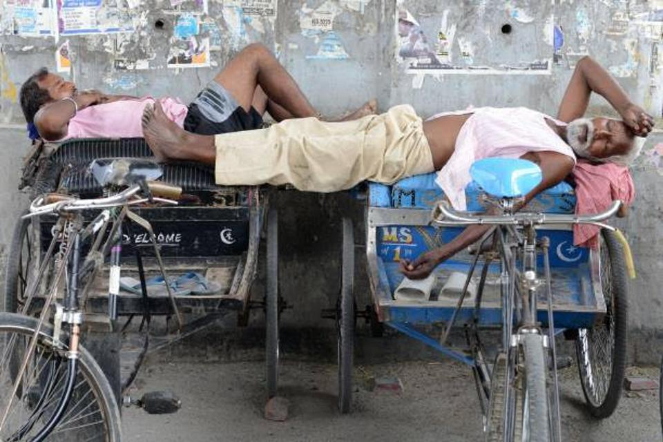 Indian men resting on their petty cabs