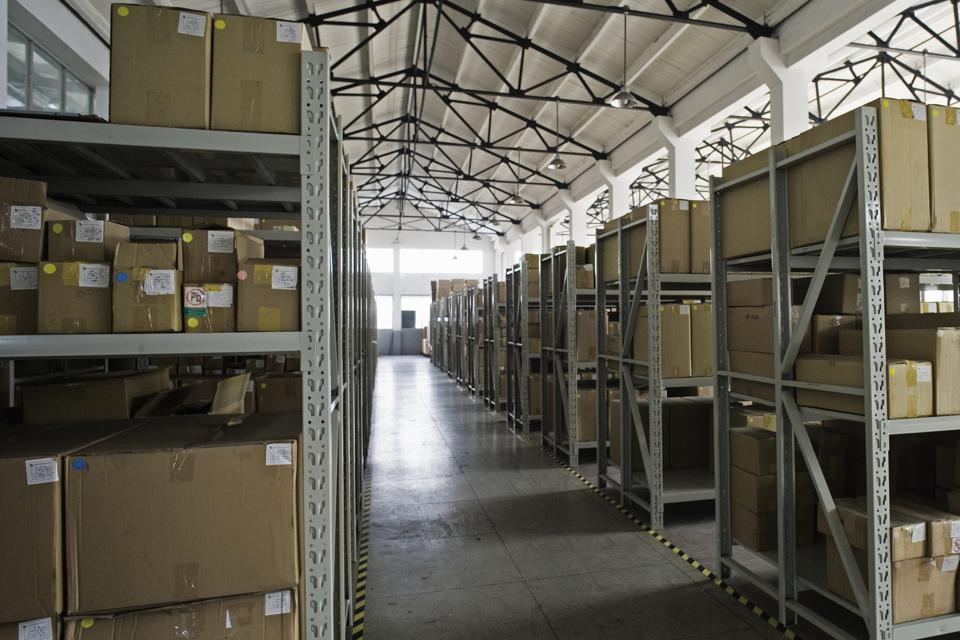 Rack of cardboard boxes in warehouse