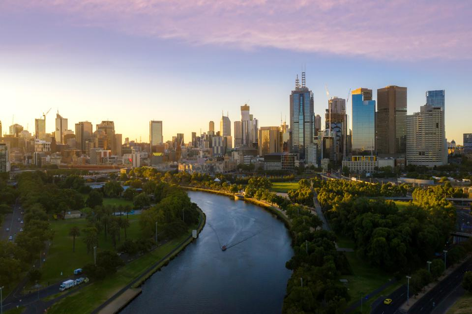 Sunset view of Yarra river and Melbourne skyscrapers business office building with evening skyline in Victoria, Australia. Australia tourism, modern city life, or business finance and economy concept