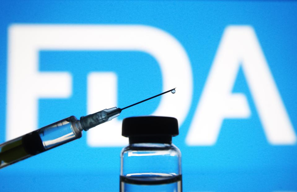 In this photo illustration, a vial and a medical syringe...