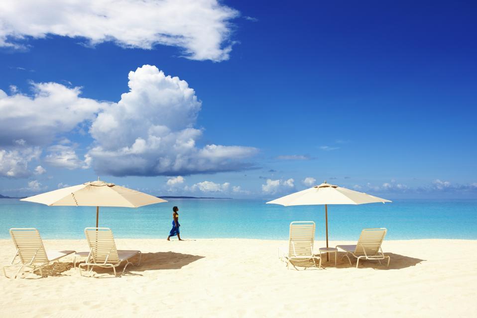 Woman walking on beach in Anguilla.
