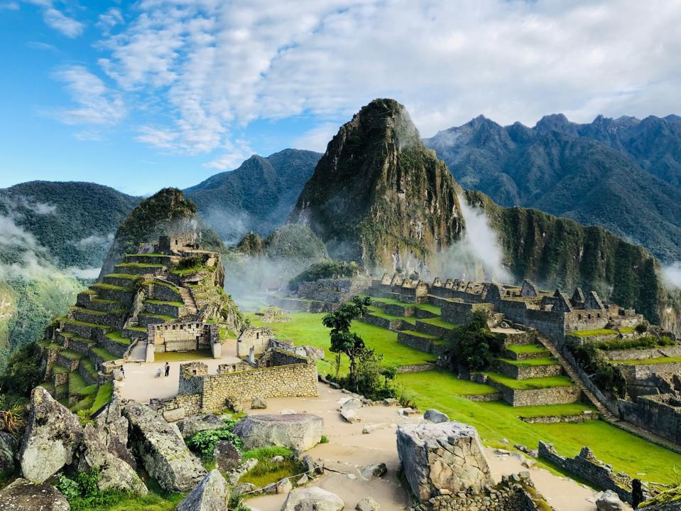 Machu Pichu and Huayna Picchu in the morning clouds