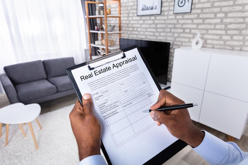 Man Filling Real Estate Appraisal Form