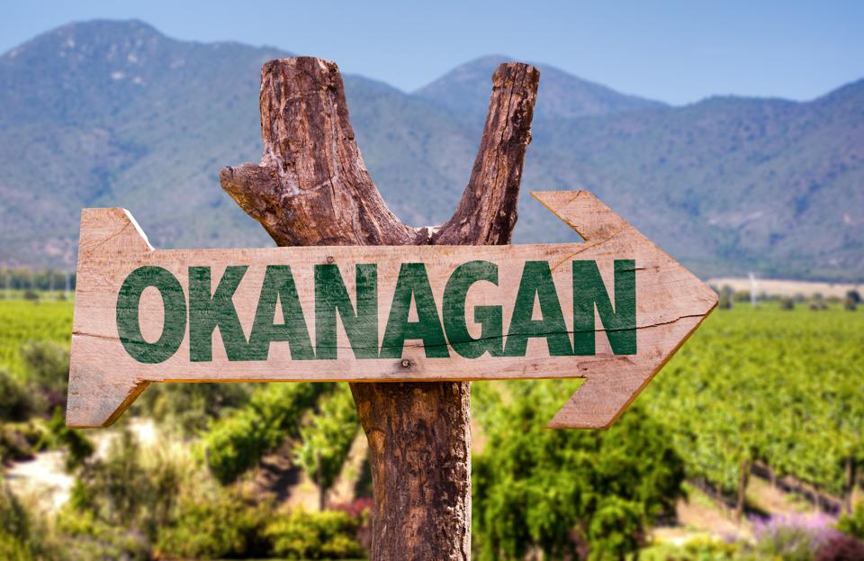 Okanagan sign with winery background