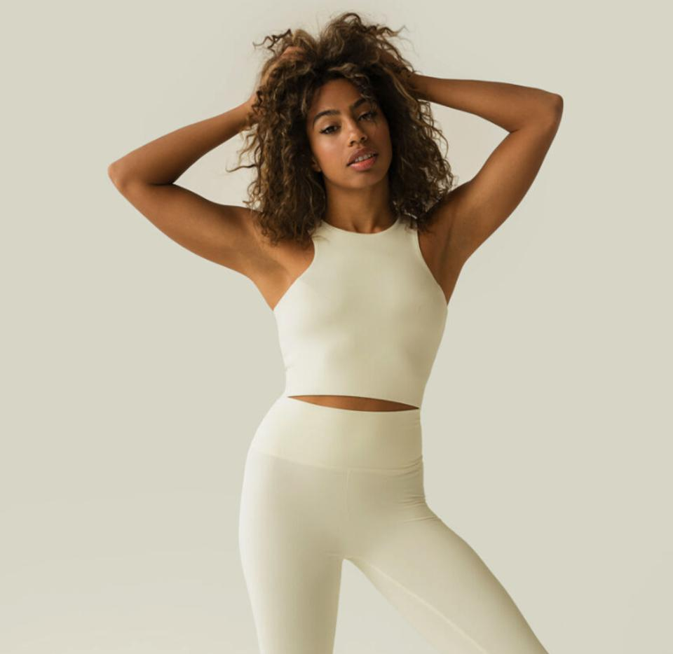 a African American model wearing ivory set of work out clothes
