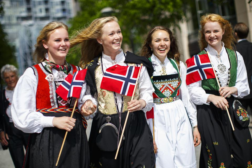 Four citizens of Norway celebrate the Norwegian Constitution Day in Oslo, Norway.