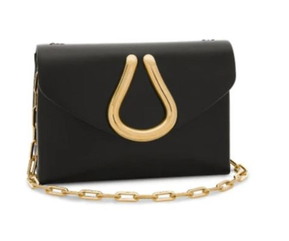 John loop bag is 100% leather with front flap, metal loop detail, and removable chain strap