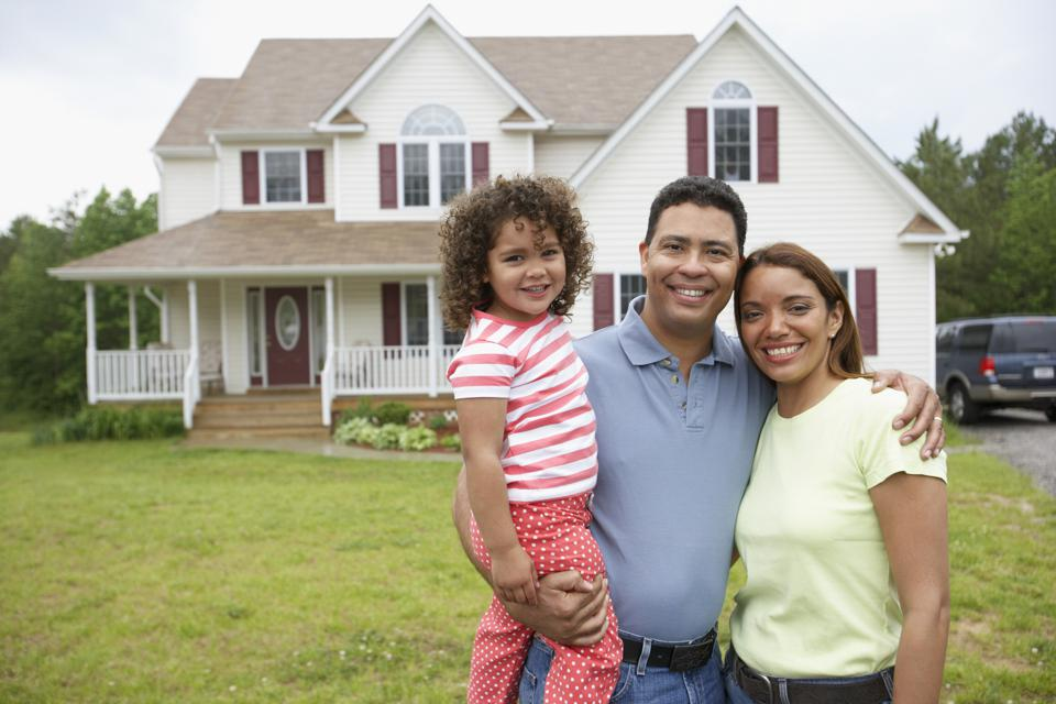 Couple with daughter together in front yard