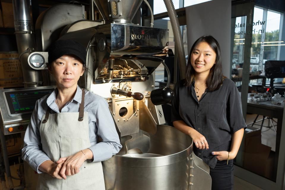 The mother-daughter owners of Bean & Bean are seen with floor-to-ceiling coffee machinery