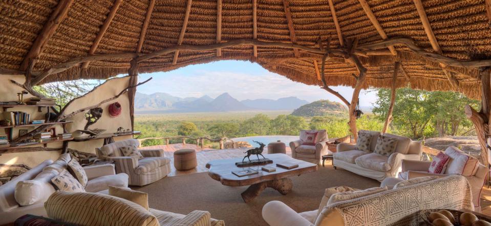 A thatched-roof, open-air lounge overlooks the bush at Sarara Camp in Samburu, Kenya.