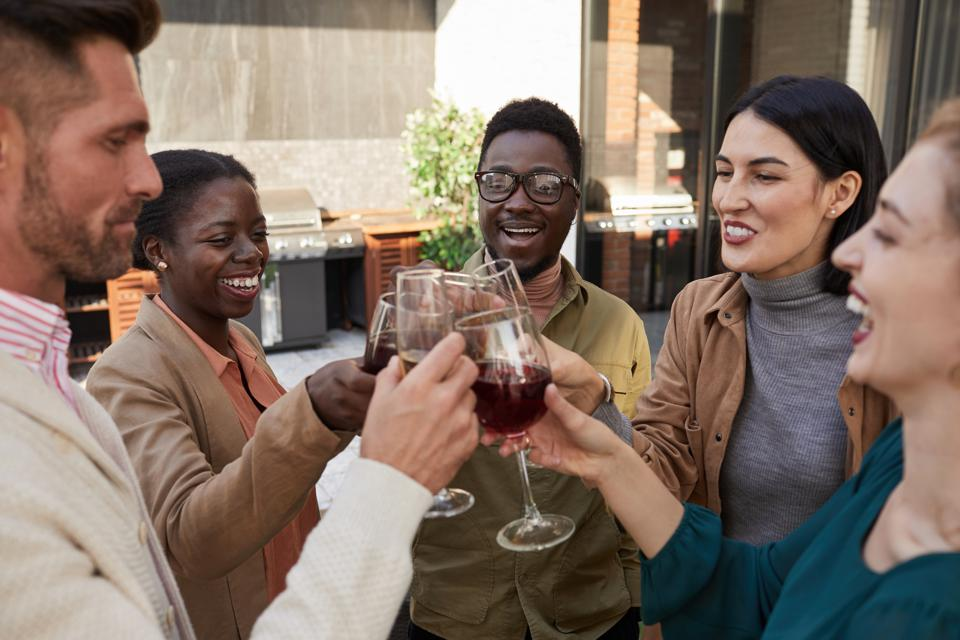 Small Group of Friends Toasting at Outdoor Party