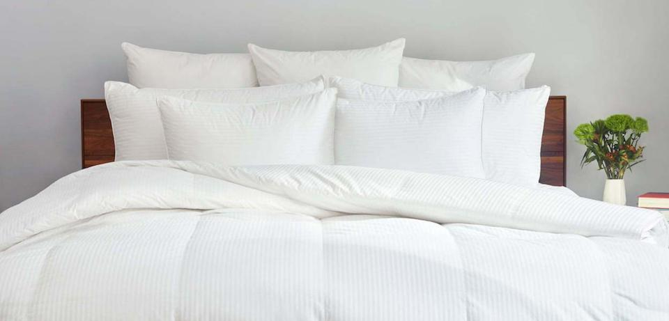 Down comforter on a bed
