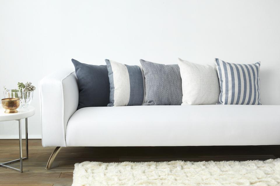 Pillow Pops Sail Away Collection -various blue pillows on a white sofa in a living room