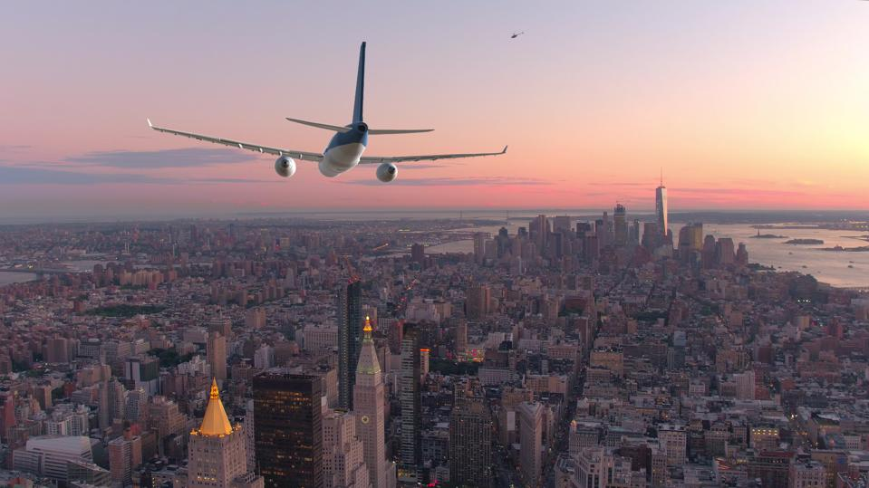 AERIAL: Passenger airplane flying over downtown Manhattan