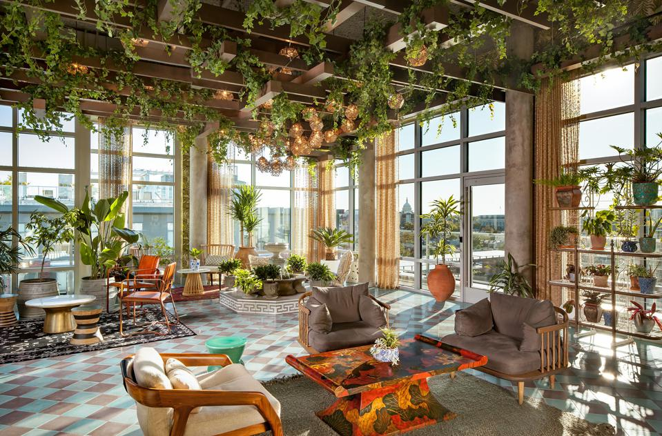 Living walls with many green plants inside an apartment project.