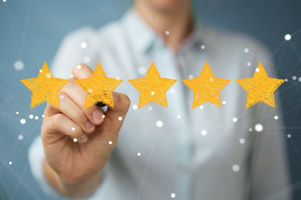 Businesswoman on blurred background rating with hand drawn stars