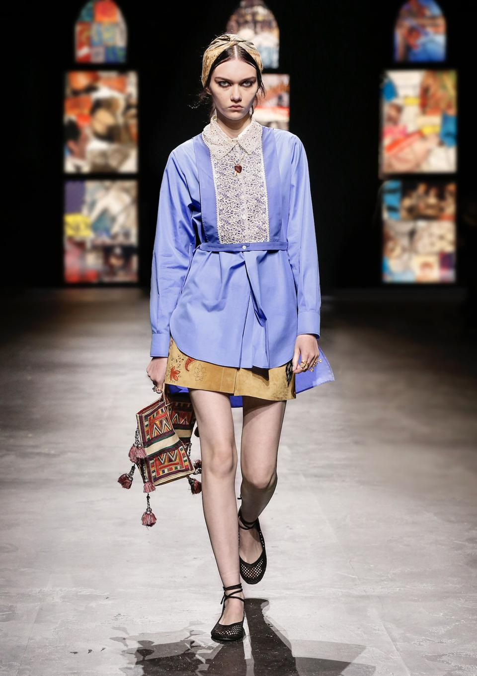 Dior Summer 2021 Look 42  Blue Cotton Poplin Plastron Shirt - $1,900  Blue Cotton Poplin Long Blouse - $1,700  Suede Skirt -$3,600  Yellow Multicolor Dior Paisley Embroidery D-Bubble Bucket Bag - $3,600  Black Mesh Embroidery Dior Poème Laced Ballerina Flat - $1,150  Multicolor Silk and Cotton Dior Patchwork Oeillets Square Scarf - $520