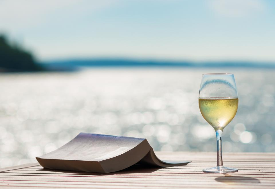 Wine and book by the ocean