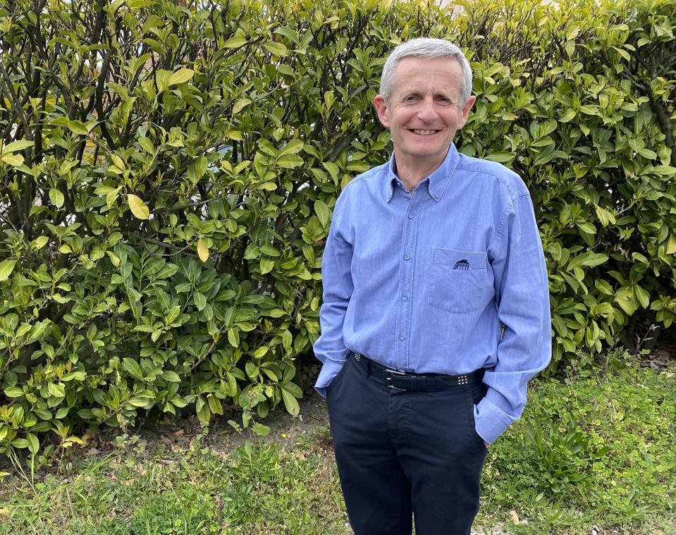 Author Gilles Berdin stands in his garden in Bordeaux