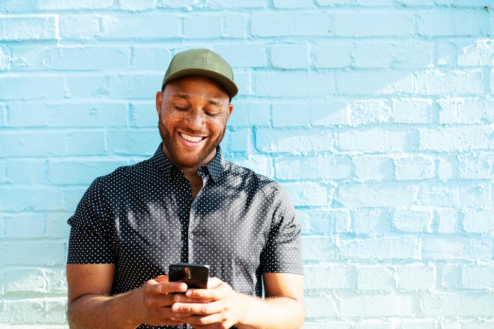 Man smiling with smart phone