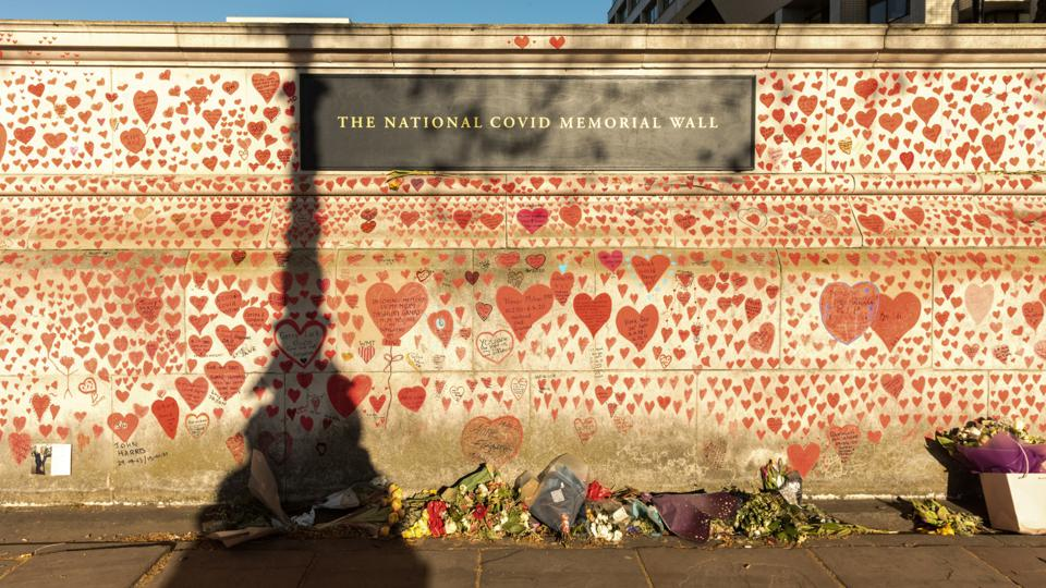 The National COVID Memorial Wall is established along the...