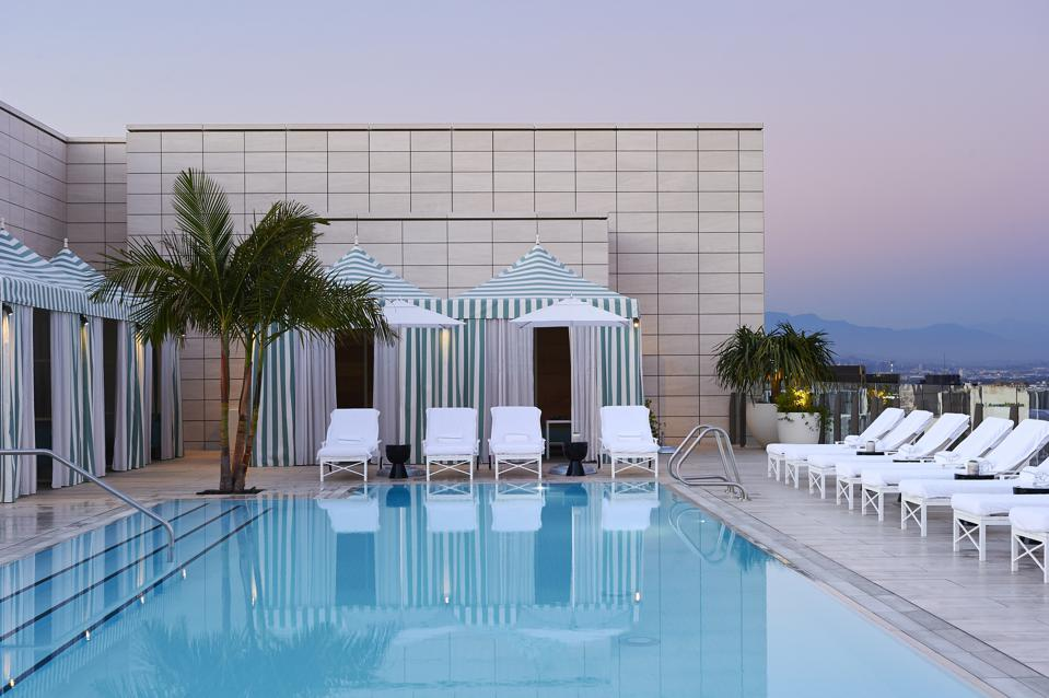 A rooftop pool in Beverly Hills with views of the city lights