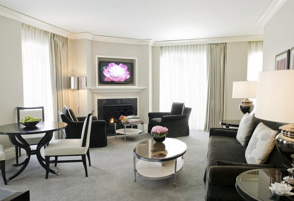 A contemporary hotel lounge with a clean design in a black and white color palette
