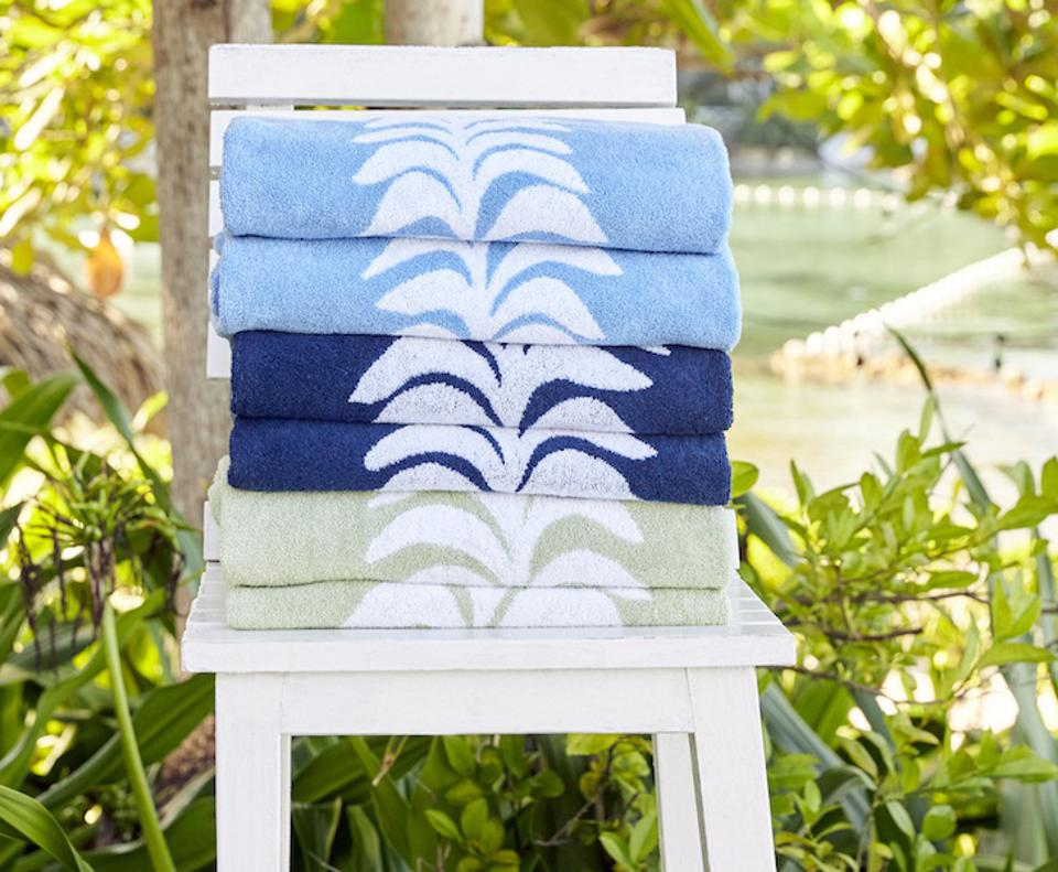 Weezie x Heather Chadduck Beach Bundle Beach towels on a chair with leaves in the backgorund