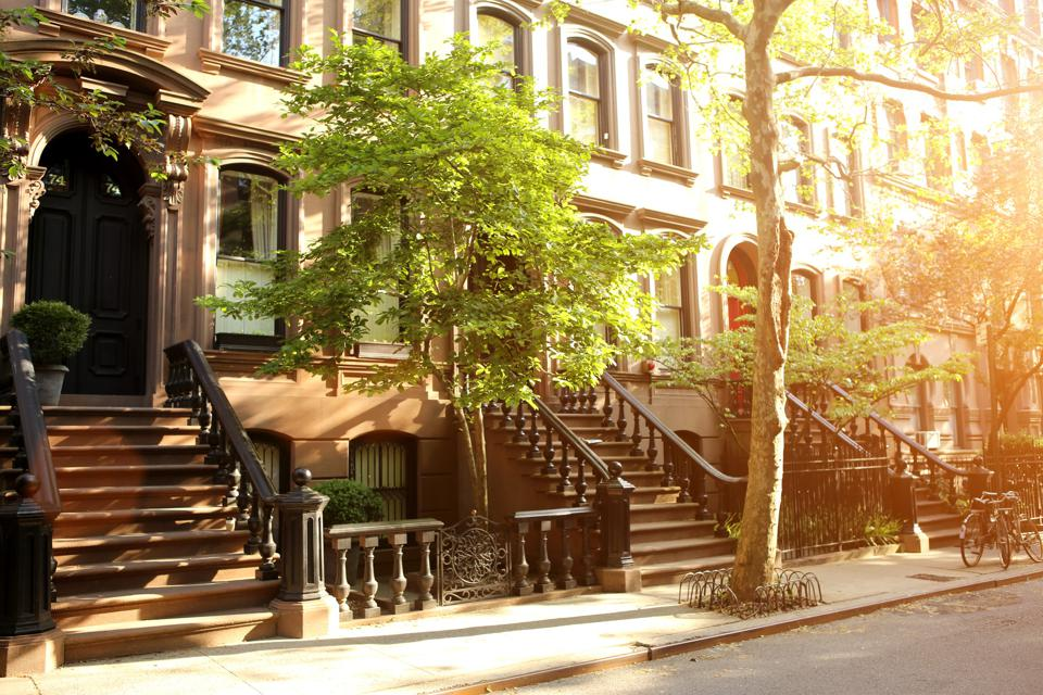 Rows of beautiful brownstones in New York City at sunset